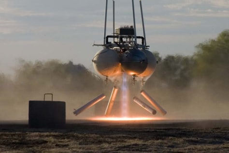 Image: Armadillo Aerospace's Pixel lunar lander entry hovers above its launch pad during a test.