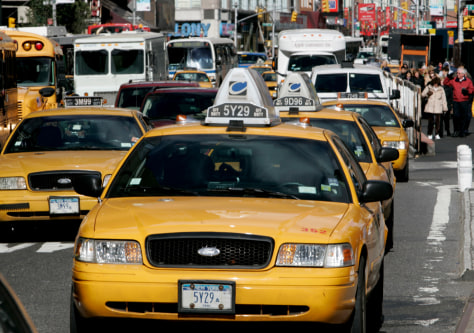 Image: Taxis drive through Times Square