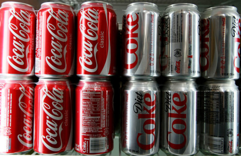 Image: Coca-Cola cans are seen in a convenience store.
