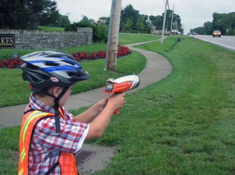 Image: Landon Wilburn, 11, points his Hot Wheels brand radar gun