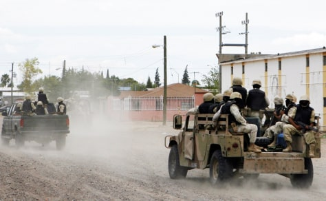 Image: Mexican Army soldiers patrol the streets of Ojinaga, Mexico