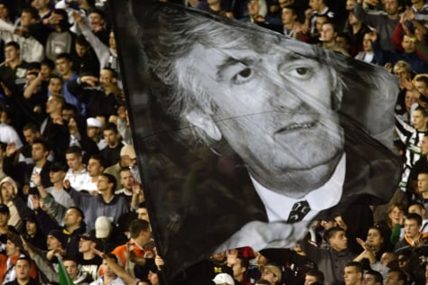 Image: Soccer fans show support for Karadzic