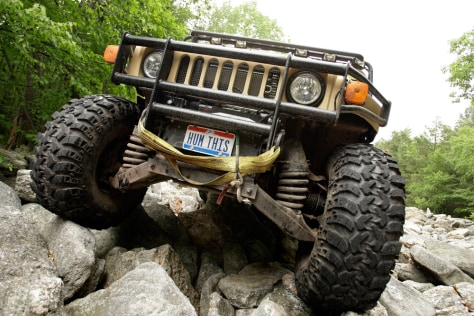 Image: John Andres drives his H1 Hummer over rocks at the Hummer Club's Straight Up or On The Rocks gathering
