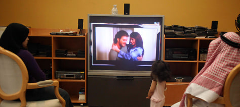"Image: A family watches the Turkish soap opera ""Noor"" in Jeddah"