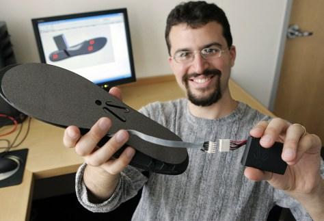 "Image: Erez Lieberman displays an ""iShoe"" insole"