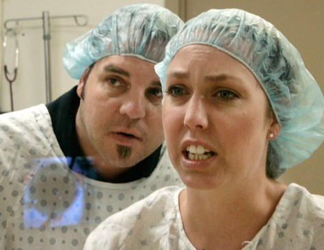 Chris Garvin, Rosie Garvin watch surgery