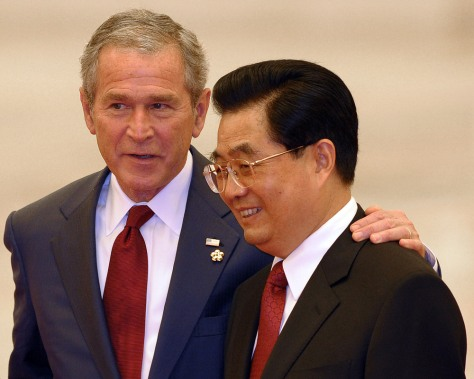 Image: US President George W. Bush puts his hand on the shoulder of Chinese President Hu Jintao