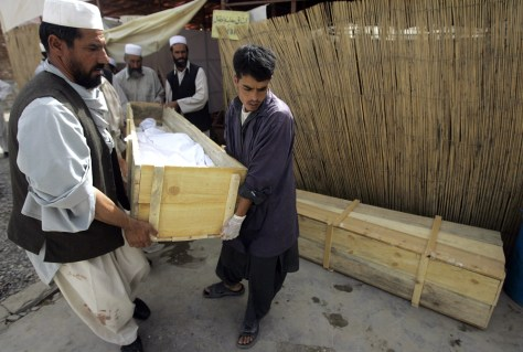 Image: Afghan paramedical staff carry the body of a foreign aid worker