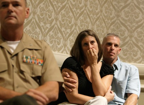 Image: Col. Doug Turlip, left, and Sgt. Maj. Tomas F. Hall and his wife, Melinda