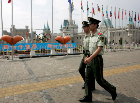 Image: Paramilitary police walk past World Park