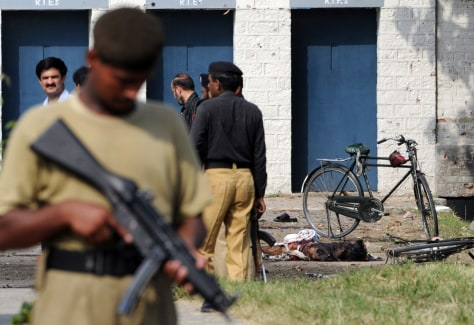 Image: Pakistani security at the site of military factory attack
