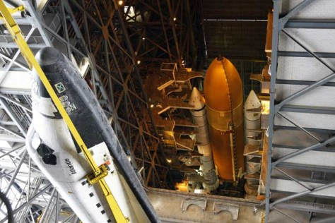 Image: In the Vehicle Assembly Building at NASA's Kennedy Space Center, space shuttle Atlantis is moved across the I-beam toward the waiting external fuel tank and twin solid rocket boosters in high bay 3.