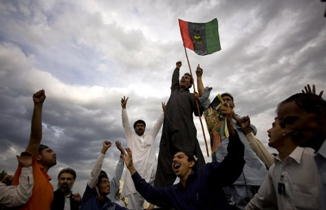 Image: Supporters from the ruling Pakistan People's Party celebrate unofficial results