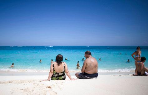 Image: Tourists sunbathe