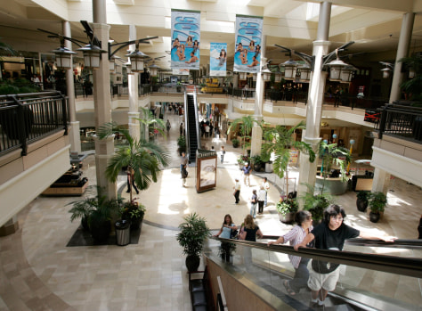 Image: Shoppers walk inside a large mall