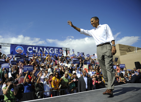 Image: Barack Obama greets supporters at the end of a rally at Plaza de Espanola