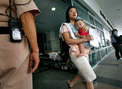 Image:A boy waits for health checkups at a hospital in Hong Kong