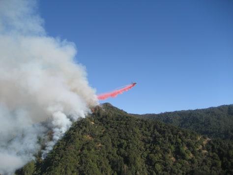 Image: Plane drops fire retardant