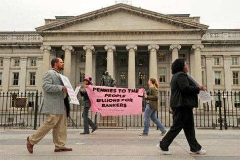 Protesters march outside of the U.S Treasury building in protest of the proposed Wall Street bailouts, Friday Sept. 26, 2008, in Washington.