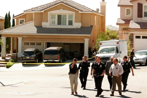 Image: Los Angeles Police investigators in front of home of six murdered family members