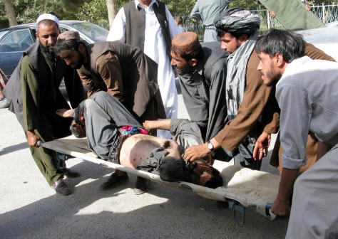 Image: A man wounded in a Taliban rocket attack