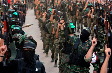 Image: Palestinian Hamas militants take part in a rally