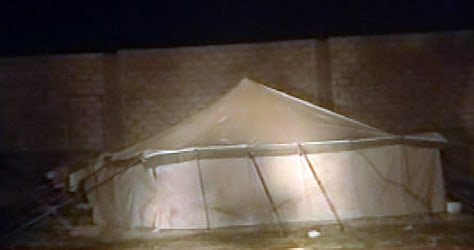 Image: A tent at a civilian building construction site is seen in this image from television