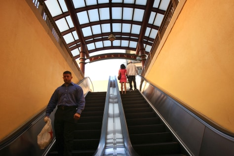 Image: An escalator in a shopping mall