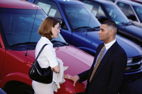 Image: Woman speaking to a car salesman