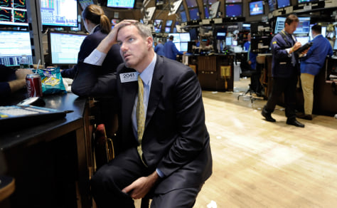 Image: Specialist Gregg Reilly works at his post on the New York Stock Exchange floor