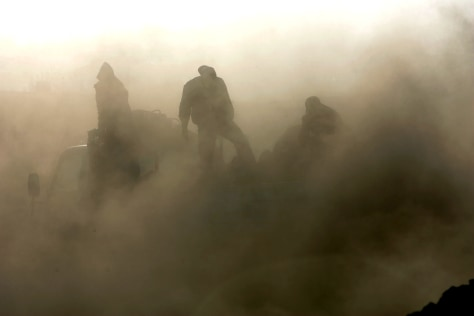 IMAGE: COAL SOOT ENGULFS WORKERS