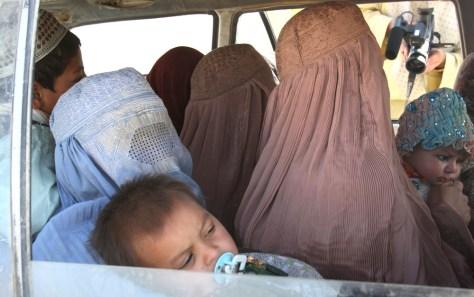 IMAGE: Afghans flee violence