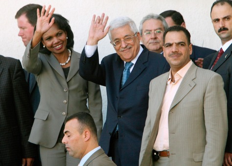 Image: U.S. Secretary of State Condoleezza Rice and Palestinian President Mahmoud Abbas wave.