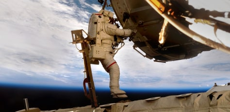 Image: Astronaut performing spacewalk at ISS
