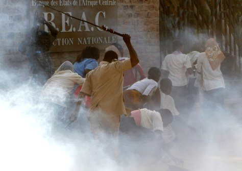 Riot police disperse secondary school students taking part in an anti-French demonstration in the capital N'Djamena