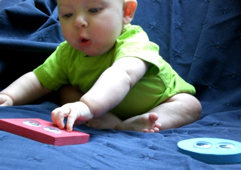 Image: Infant choosing toys