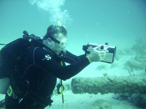 Image: Indiana University scientist Charles Beeker examines possible wreckage from Quedagh Merchant