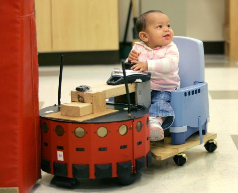 Image: Baby guides a robot