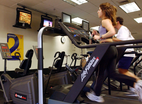 Image: People run on treadmills at a New York Sports Club January 2, 2003 in Brooklyn, New York.