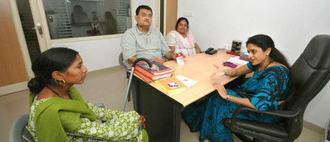 Image: Dr. Nayna Patel, right, counsels a woman, left, who wants to become a surrogate mother; listening are a couple seeking a surrogate mother