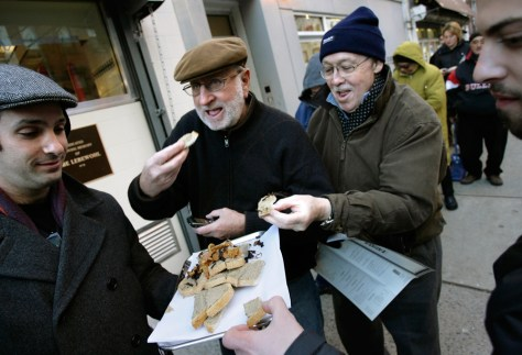 Image: Chopped liver is served to patrons waiting outside in line for the re-opening of the 2nd Avenue Deli in New York
