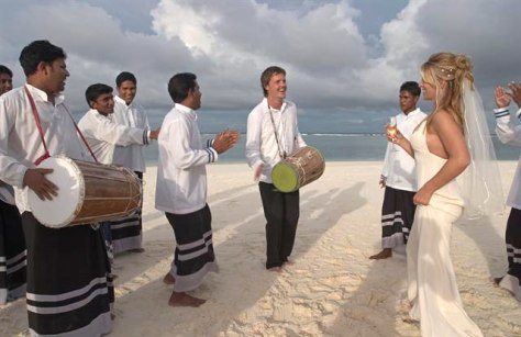 Image: Bride on beach One&Only Reethi Rah