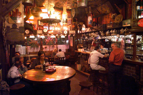 Image: Customers enjoy a drink at the Dulle Griet bar in Ghent, Belgium