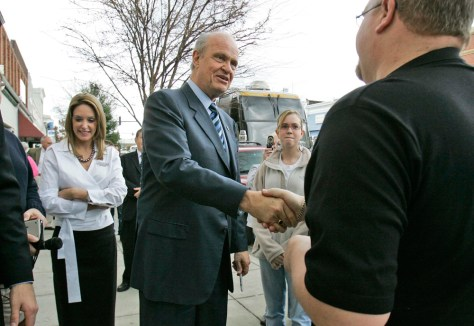 Image: Republican presidential hopeful former Sen. Fred Thompson, R-Tenn., center, and his wife Jeri, left, stop to meet people on Main Street Tuesday, Jan. 8, 2008 in Camden, S.C.