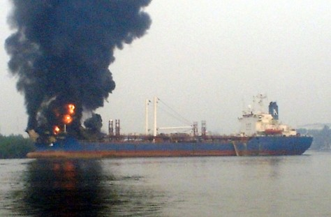 Image: A plume of smoke rises from an oil tanker after an explosion in Port Harcourt