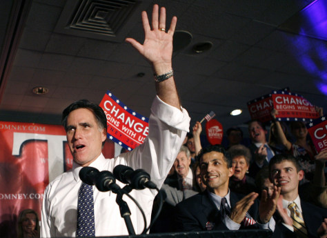 Image: US Republican presidential candidate and former Massachusetts Governor Mitt Romney waves to his supporters at his Michigan primary night rally in Southfield, Michigan