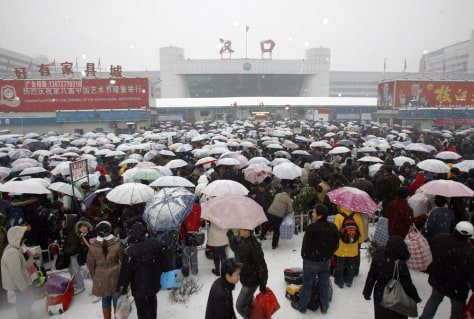 Image: Stranded train passengers in China