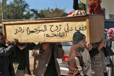 Image: Iraqis carry relative's coffin