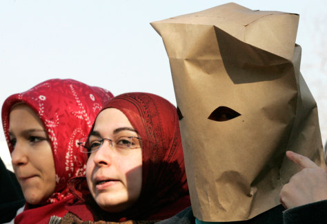 Image: Women wearing paper bags and headscarves