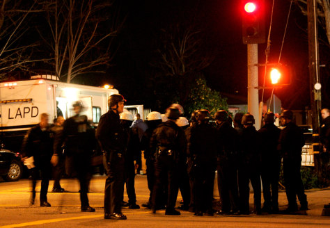 Image: Los Angeles police officers congregate at a standoff.
